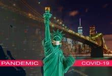 coronavirus-epidemic-word-covid-19-on-brooklyn-bridge-at-dusk-new-york-city-with-statue-of-liberty