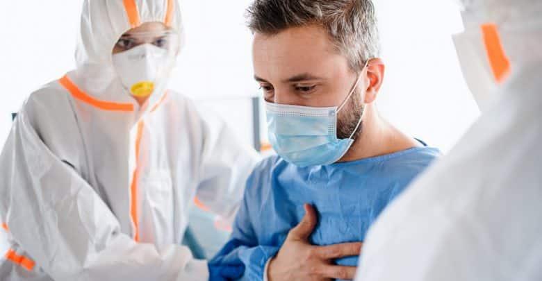 Doctors and infected patient in quarantine in hospital, coronavirus concept.